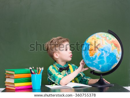 Young boy exploring the globe