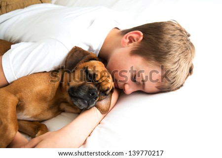 Young Boy Fell asleep Hugging his Dog