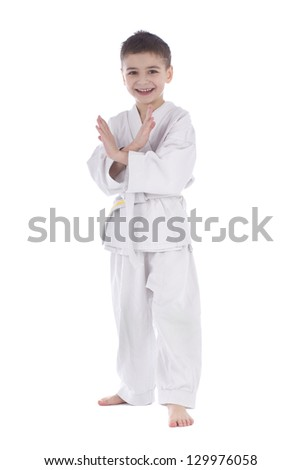 Young boy fighter in kimono taking pose isolated on white background - stock photo