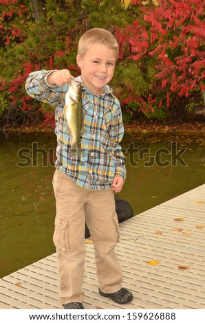 young boy fishing - stock photo
