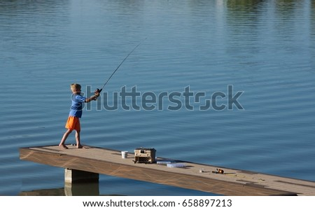 Young Boy Fishing Off Dock
