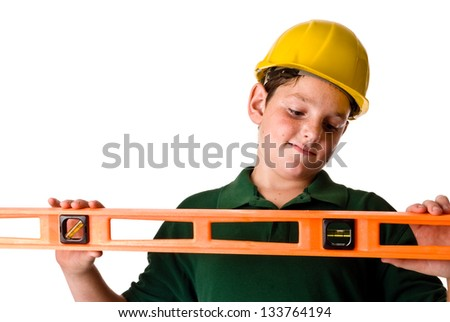 Young boy - future construction worker - stock photo