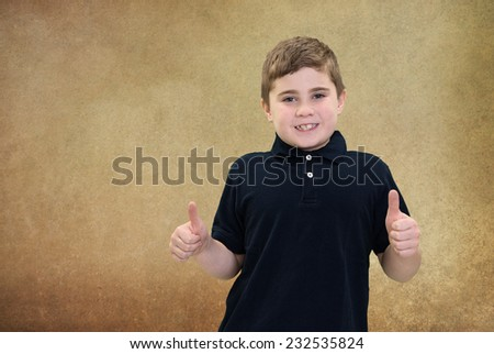 Young Boy Gesturing Encouragement with Thumbs Up - stock photo
