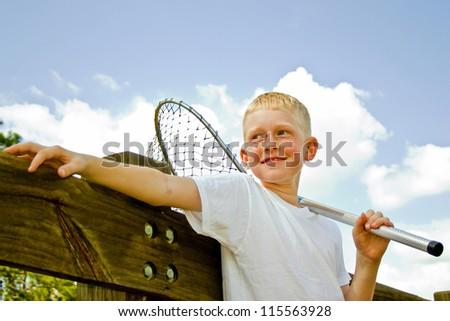Young  boy going fishing - stock photo