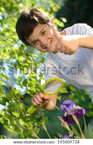 Young boy happy -Exploring Nature - stock photo