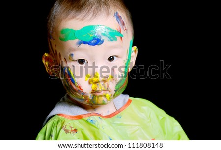 young boy has a colorful face when played color game - stock photo