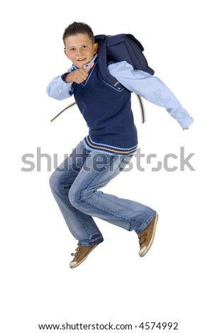 Young boy having fun. Jumping in the air with backpack. Looking at camera. Thumb up. Isolated on white in studio, side view - stock photo