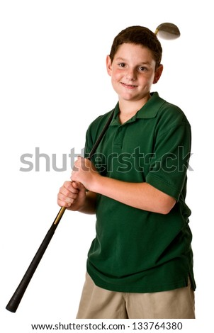 Young boy holding a golf club - stock photo