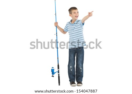 Young boy holding fishing rod pointing at something away