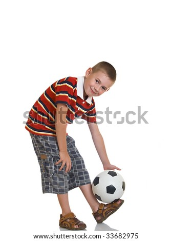 young boy holding football in his hand - stock photo