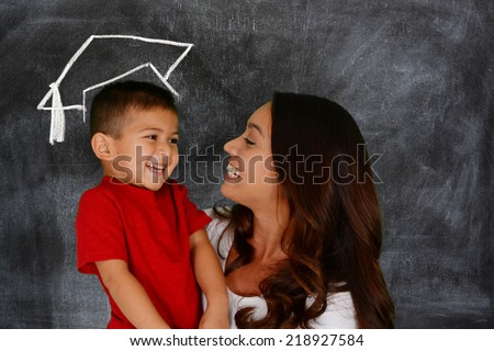 Young boy holding his books before school - stock photo