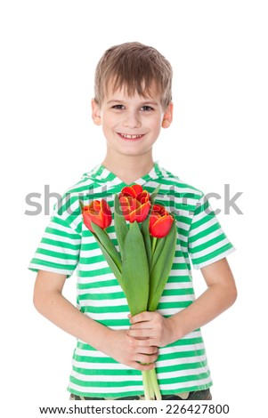 Young boy holding tulips isolated on white - stock photo