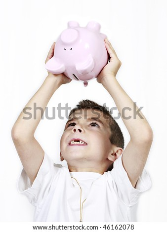 Young boy holding up Piggy Bank isolated on white - stock photo
