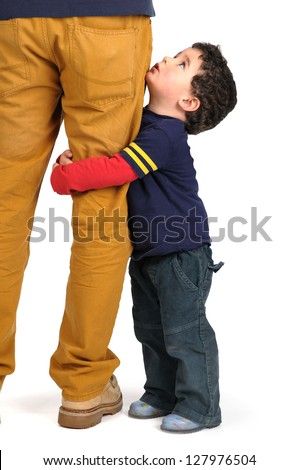 Young boy hugging his father's leg - stock photo
