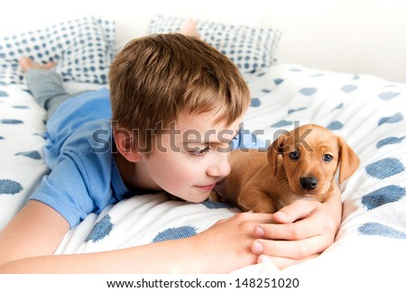 Young Boy Hugging his Puppy