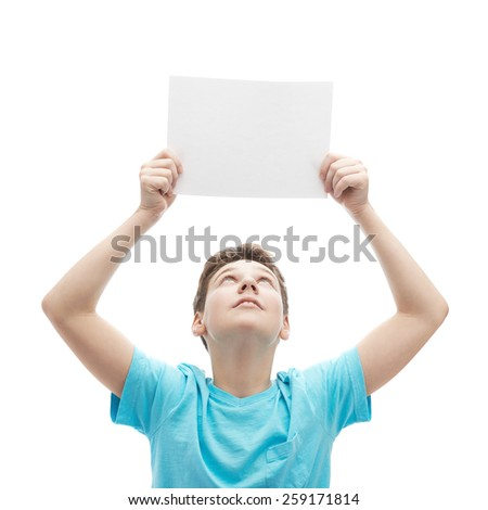 Young boy in a cyan t-shirt, holding an empty copyspace sheet of paper over his head, composition isolated over the white background - stock photo