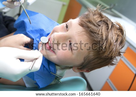 Young boy in a dental surgery - stock photo