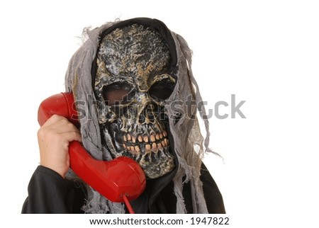 Young boy in a ghoul halloween costume on telephone