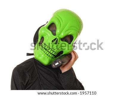 Young boy in a ghoul halloween costume on the telephone
