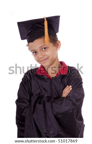 Young boy in a graduation gown and cap.