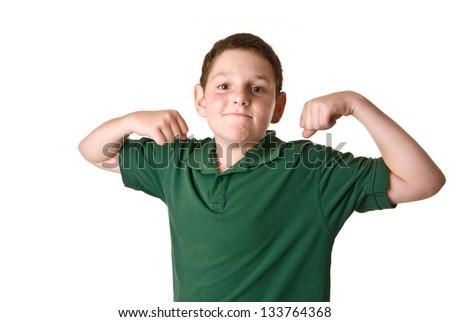 Young boy in a green polo shirt flexing - stock photo