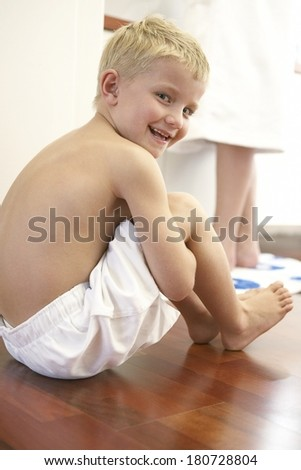 Young boy in bathroom  - stock photo