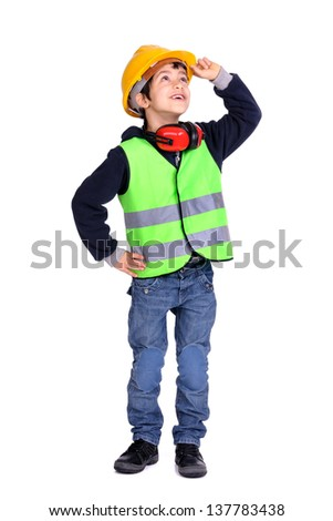 Young boy in construction gear - stock photo