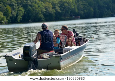 young boy in fishing boat