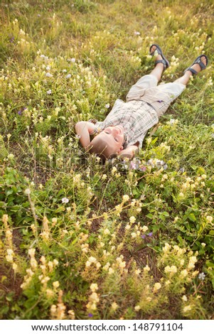 young boy in flowers - stock photo