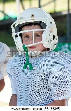 Young boy in football uniform - stock photo