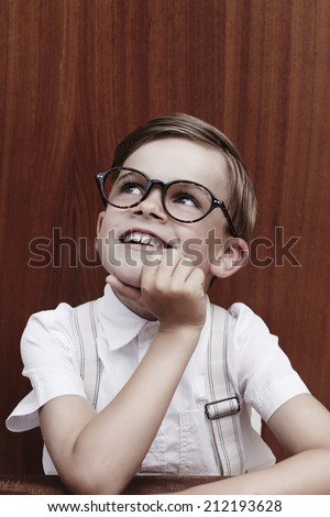 Young boy in glasses, looking up  - stock photo