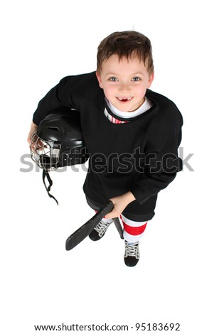 Young boy in ice hockey gear against white - stock photo