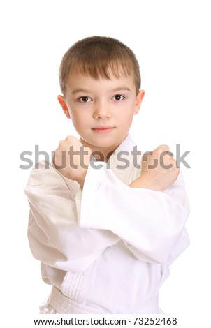 Young boy in kimono over pure white background