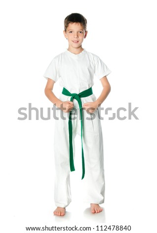 Young boy in kimono with green belt  on a white background - stock photo
