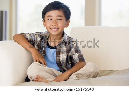 Young boy in living room smiling - stock photo
