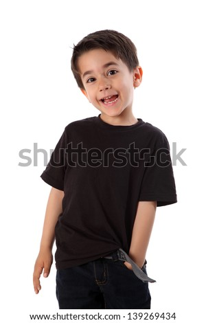 Young boy in studio with black shirt and jeans - stock photo