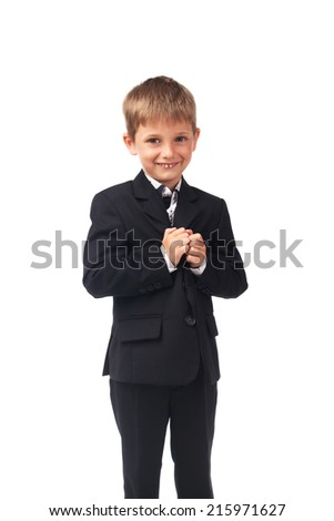 Young boy in the black suit isolated on white
