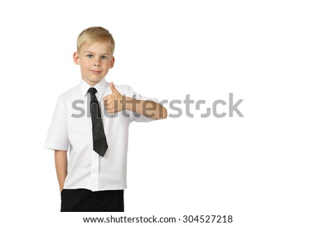 Young boy in white shirt and black tie shows thumb up isolated on white background with copy space for text or advertising - successful business concept - stock photo