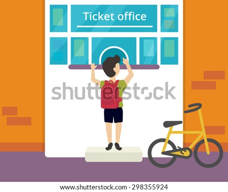 Young boy is buying a ticket to circus - stock photo