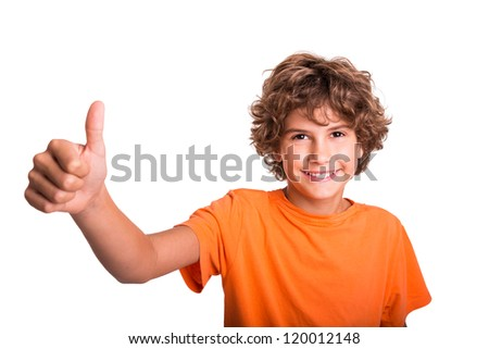 Young boy is happy. Thumb up and smiling. - stock photo