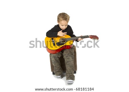 Young boy is making music on a white background.