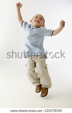 Young boy jumping for joy - stock photo