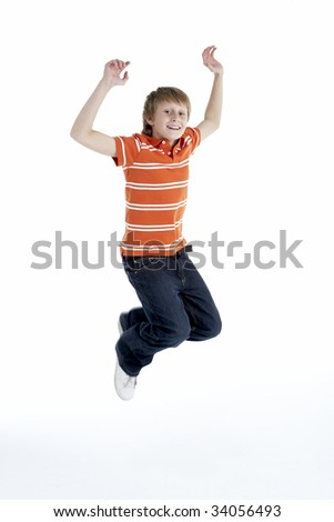 Young Boy Jumping In Air - stock photo