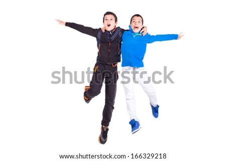 Young boy jumping isolated in white - stock photo