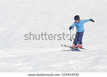 Young boy landing a ski jump - stock photo