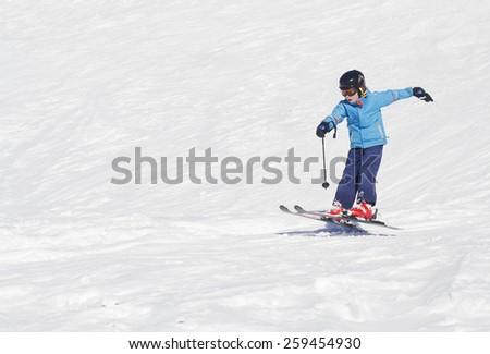 Young boy landing a ski jump - stock photo