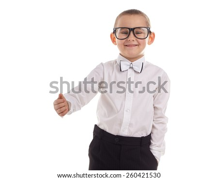 Young boy laughing with his thumb up