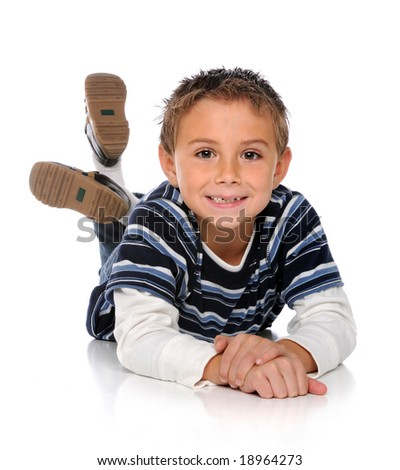 Young boy laying on the floor isolated over a white background - stock photo
