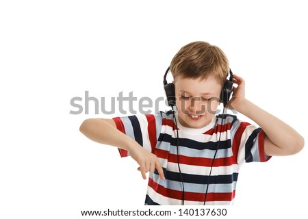 young boy listening a music in a headphones isolated