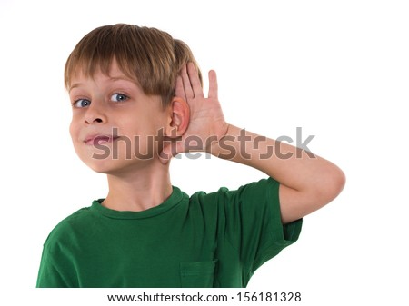 young boy listening something - stock photo